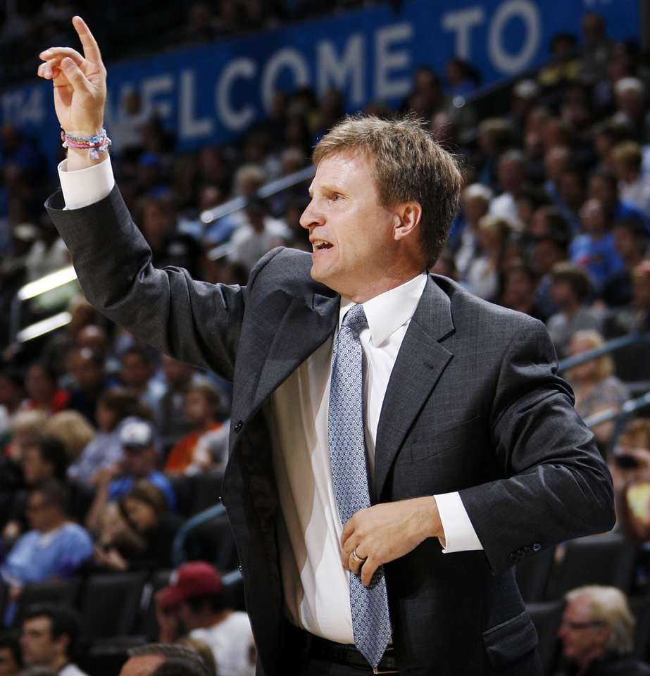 Photo - Oklahoma City head coach Scott Brooks gives instructions to his team during the preseason NBA basketball game between the New Orleans Hornets and the Oklahoma City Thunder at the Ford Center in Oklahoma City, Thursday, October 21, 2010. Photo by Nate Billings, The Oklahoman