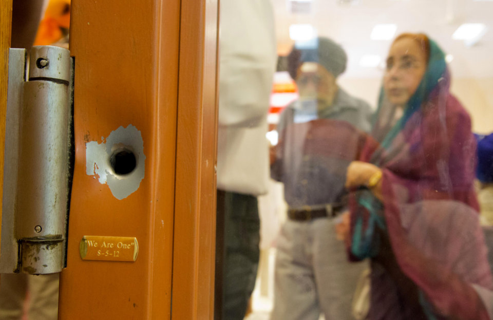 Photo -   FILE - This Aug. 12, 2012 file photo shows a bullet hole on a door frame inside the Sikh temple in Oak Creek, Wis. Frightening episodes of gun violence have been splayed across front pages with alarming frequency this campaign season: The movie theater killings in Colorado, the Sikh temple shootings in Wisconsin, the gun battle outside the Empire State Building, and more. Guns are used in two-thirds of homicides, according to the FBI. But the murder rate is less than half what it was two decades ago. (AP Photo/Jeffrey Phelps, File)