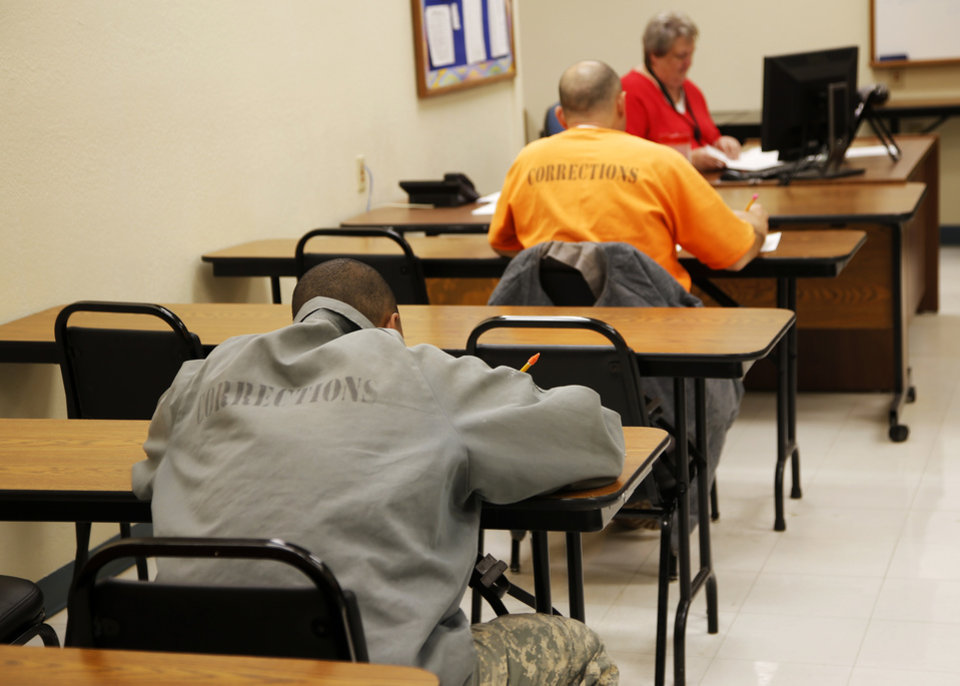 Photo -  Inmates work in a classroom at the Bill Johnson Correctional Center in Alva. [Photo by Nate Billings, The Oklahoman]