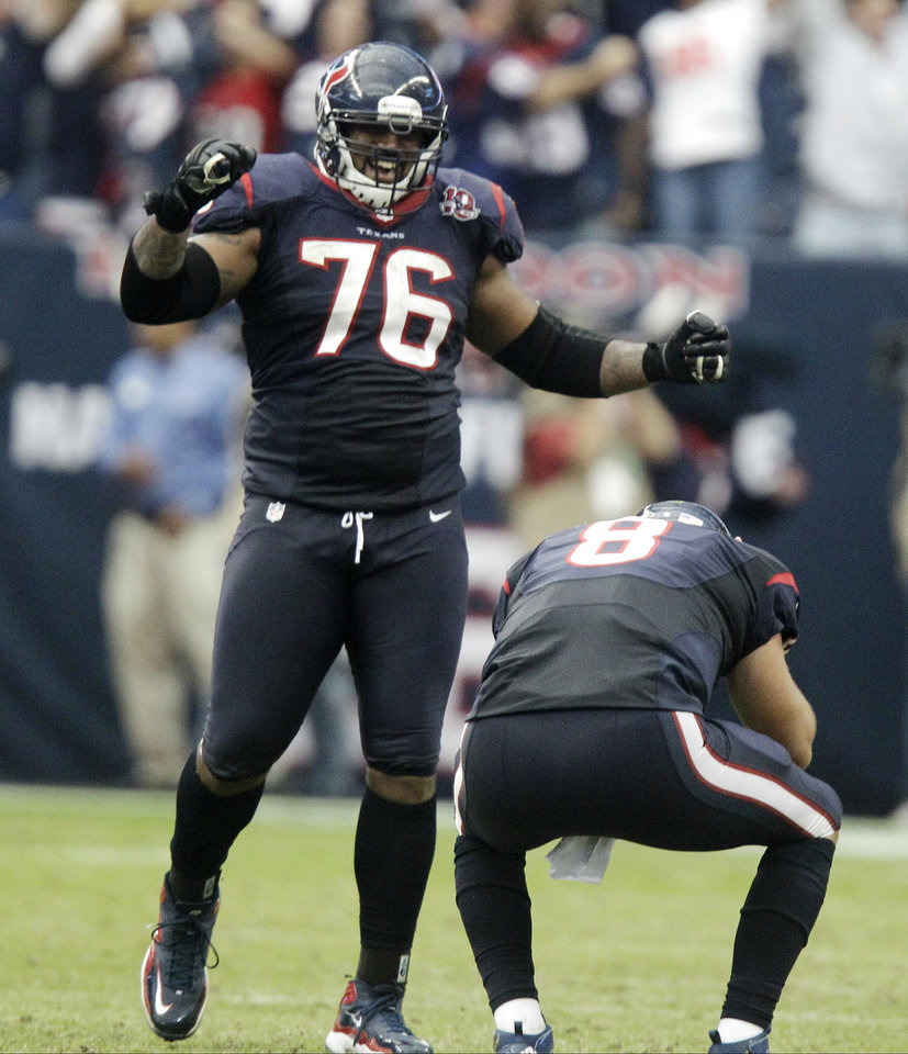 Photo -   Houston Texans quarterback Matt Schaub (8) and Duane Brown (76) celebrate after beating the Jacksonville Jaguars 43-37 in overtime of an NFL football game Sunday, Nov. 18, 2012, in Houston. (AP Photo/Patric Schneider)