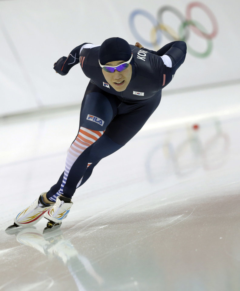 Photo - South Korea's Mo Tae-bum competes in the second heat of the men's 500-meter speedskating race at the Adler Arena Skating Center at the 2014 Winter Olympics, Monday, Feb. 10, 2014, in Sochi, Russia.(AP Photo/Matt Dunham)