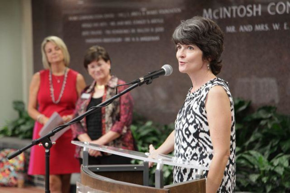 Darla deStiguer, wife of  Oklahoma Christian University�s President, welcomes guests to the  First Ladies Tea. Co-hosts were Marty Johnson, Judy Branch and Nancy O�Neal, wives of former presidents. More than 100 OC students, past and present faculty women and friends and neighbors were there. It was in the McIntosh Conservatory at OCU.  The event also launched the First Ladies Collection, a new initiative that provides an opportunity for people to donate books to OC�s Beam Library in honor of special women. (Photo provided).