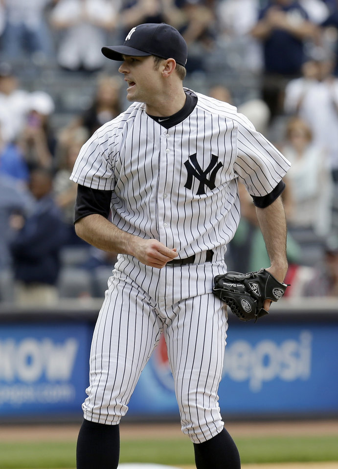 Photo - New York Yankees relief pitcher David Robertson reacts after striking out Pittsburgh Pirates' Tony Sanchez to end the first baseball game of a double-header at Yankee Stadium, Sunday, May 18, 2014 in New York. The Yankees defeated the Pirates 4-3. (AP Photo/Seth Wenig)