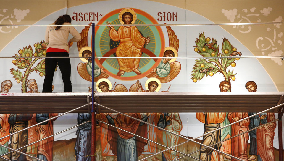 Photo - Irene Papas checks details during a recent iconography project at St. Elijah Orthodox Christian Church, 15000 N May. Papas used her college spring break to help her father, iconographer Nick Papas of Houston,complete the iconography project at the Oklahoma City church.  The Oklahoman - Steve Gooch