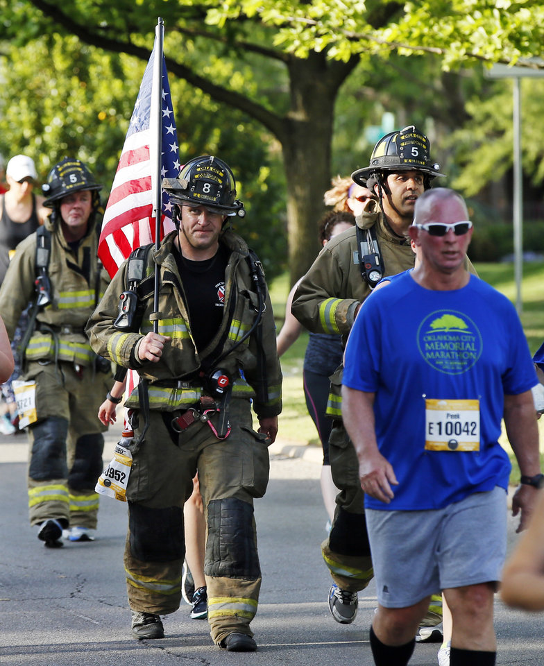 Photo - Participants, including Oklahoma City firefighters, travel north on Shartel Ave. during the Oklahoma City Memorial Marathon in Oklahoma City, Sunday, April 24, 2016. Photo by Nate Billings, The Oklahoman