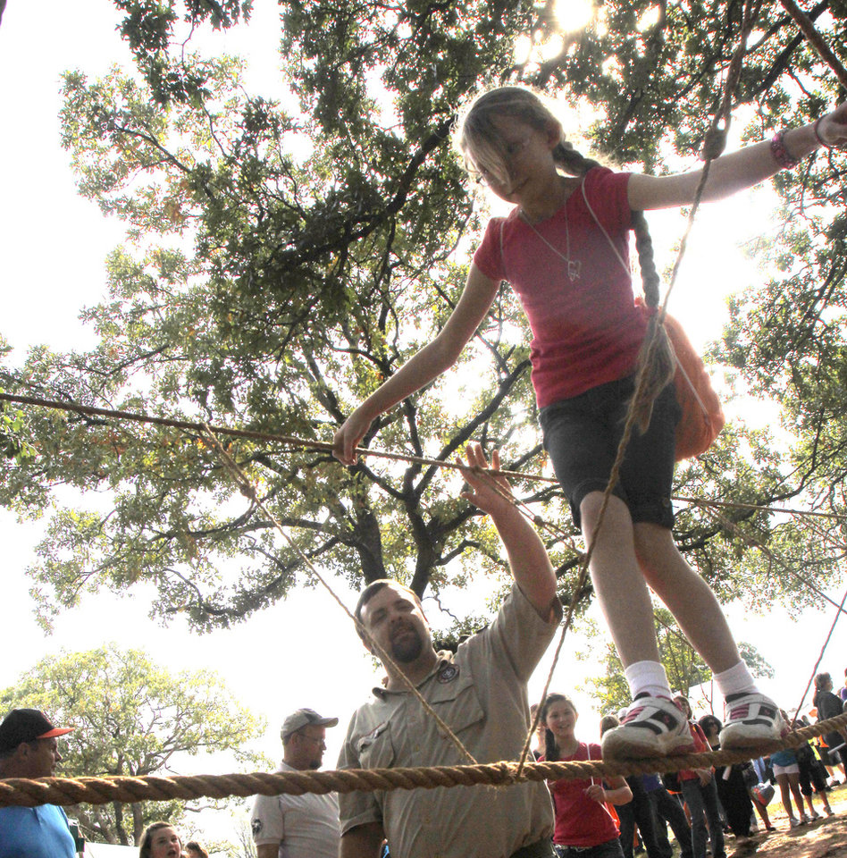 Photo - Caiton Beesley, from Pretty Watter School, crosses a rope bridge during school day of the Oklahoma Wildlife Expo at the Lazy E Arena and Ranch in Guthrie, OK, Friday, September 28, 2012,  By Paul Hellstern, The Oklahoman