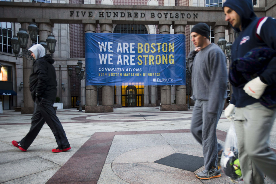Photo - Runners make their way to load onto busses ahead of the 118th Boston Marathon Monday, April 21, 2014 in Boston. (AP Photo/Matt Rourke)