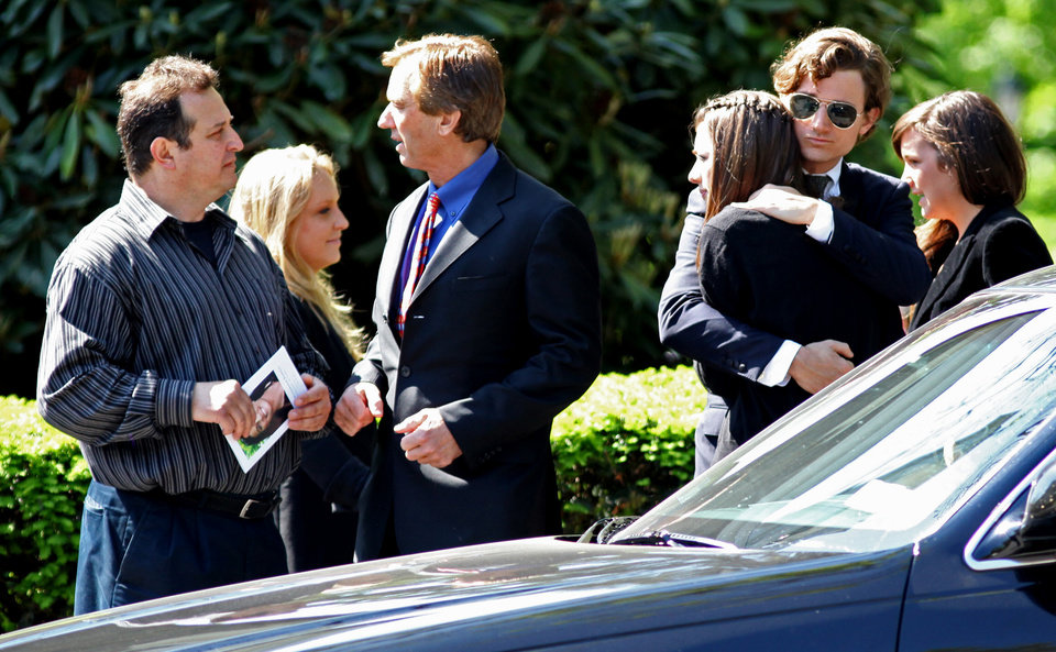 Photo -   Members of the Kennedy family arrive for the funeral of Mary Richardson Kennedy, the estranged wife of Robert F. Kennedy Jr., at St. Patrick's Church in Bedford, N.Y., Saturday, May 19, 2012. Kennedy was found dead of an apparent suicide this week at her home in Bedford. Robert F. Kennedy Jr., stands third from left. (AP Photo/Craig Ruttle)