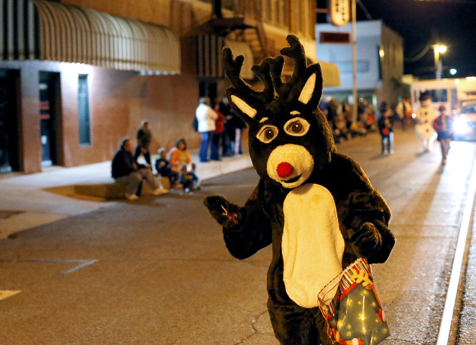 Right: Rudolph waves to people during a Christmas parade in El Reno on Thursday.