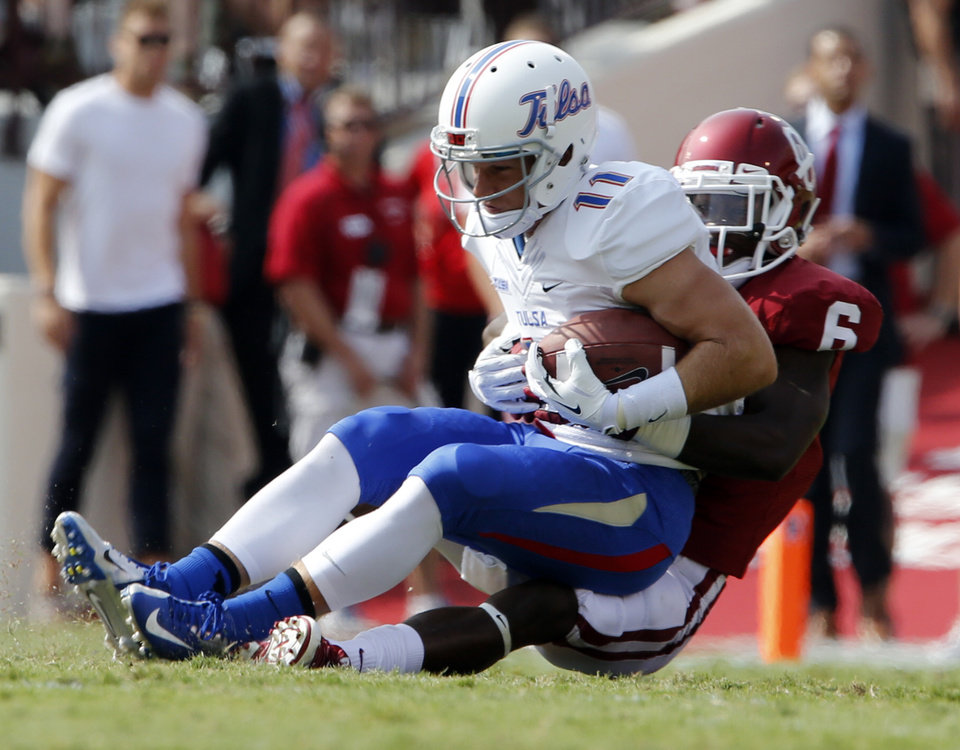 Oklahoma's Stanvon Taylor (6) brings down Tulsa's Derek Patterson (11) during a college football game between the University of Oklahoma Sooners (OU) and the Tulsa Golden Hurricane (TU) at Gaylord Family-Oklahoma Memorial Stadium in Norman, Okla., on Saturday, Sept. 14, 2013. Photo by Steve Sisney, The Oklahoman