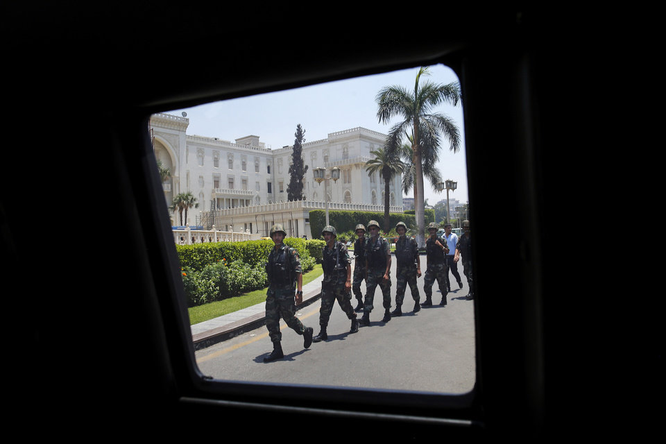 Photo - Egyptian security personnel are seen outside the presidential palace ahead of U.S. Secretary of State John Kerry's arrival for his meeting with Egyptian President Abdel-Fattah el-Sissi in Cairo, Egypt, Tuesday, July 22, 2014. Kerry is hoping to get international support as he pushes for a Mideast cease-fire, but he acknowledges the differences between Israel and Hamas run very deep and must be addressed in any long-term solution. (AP Photo/Pool)