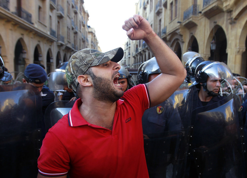 Photo - A civil society protester chant slogans against Lebanese lawmakers during a demonstration protesting the extension of parliament's mandate, near Parliament in Beirut, Lebanon, Friday, June 21, 2013. Lebanon's parliament on May 29 extended its term by a year and a half, skipping scheduled elections because of the country's deteriorating security linked to the civil war next door in Syria. (AP Photo/Bilal Hussein)