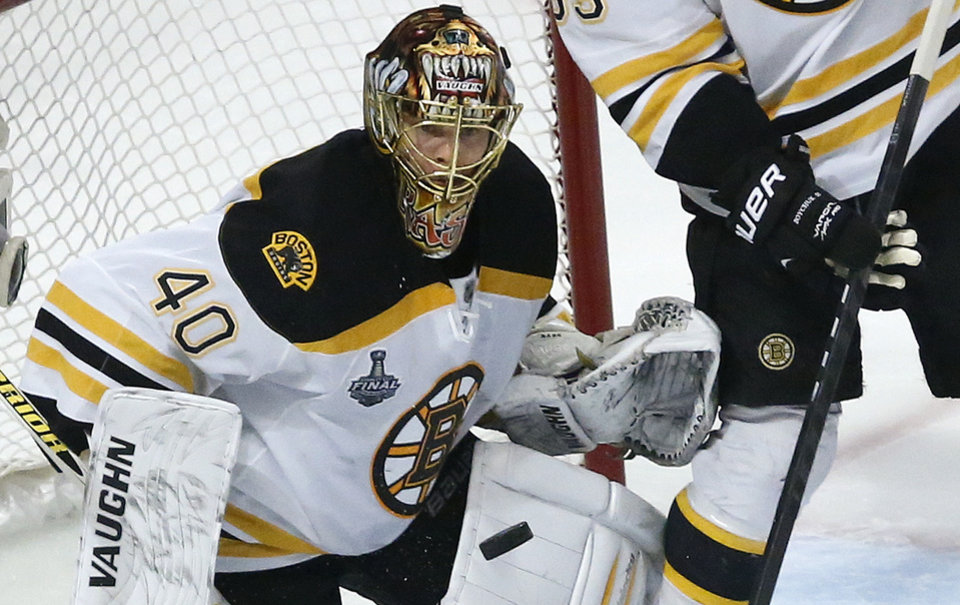 Photo - Boston Bruins goalie Tuukka Rask (40) watches the rebound after blocking a shot against the Chicago Blackhawks in the first period during Game 2 of the NHL hockey Stanley Cup Finals, Saturday, June 15, 2013, in Chicago. (AP Photo/Charles Rex Arbogast)