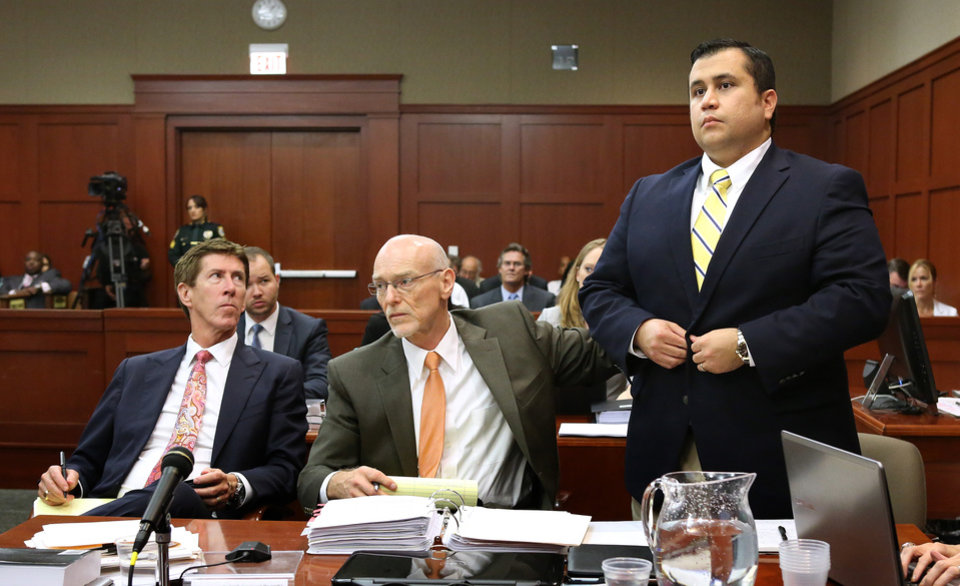 Photo - George Zimmerman, right, stands next to his attorneys, Mark O'Mara, left,  and Don West, during the 15th day of his trial in Seminole circuit court, in Sanford, Fla., Friday, June 28, 2013. Zimmerman has been charged with second-degree murder for the 2012 shooting death of Trayvon Martin.(AP Photo/Orlando Sentinel, Joe Burbank, Pool)
