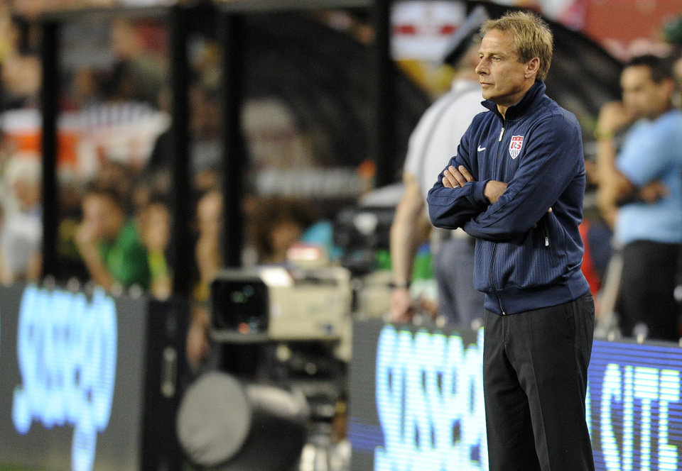 Photo -   United States head coach Jurgen Klinsmann looks on from the sidelines during the first half of an international friendly soccer game against Brazil, Wednesday, May 30, 2012, in Landover, Md. (AP Photo/Nick Wass)