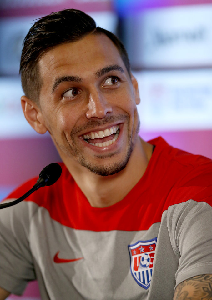 Photo - United States' Geoff Cameron reacts to a question during a press conference before a training session in Sao Paulo, Brazil, Thursday, June 19, 2014.  The United States will play against Portugal in group G of the 2014 soccer World Cup on June 22. (AP Photo/Julio Cortez)
