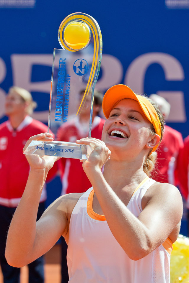 Photo - Canadian Eugenie Bouchard hold the trophy after defeating Czech  Karolina Pliskova at the WTA final in Nuremberg, Germany, Saturday, May 24, 2014. Bouchard won 6-2, 4-6, 6-3. (AP Photo/dpa, Daniel Karmann)