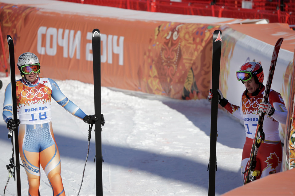 Photo - Canada's Erik Guay, right, and Norway's Aksel Lund Svindal stand in the finish area after a men's downhill training run for the Sochi 2014 Winter Olympics, Saturday, Feb. 8, 2014, in Krasnaya Polyana, Russia.  (AP Photo/Gero Breloer)