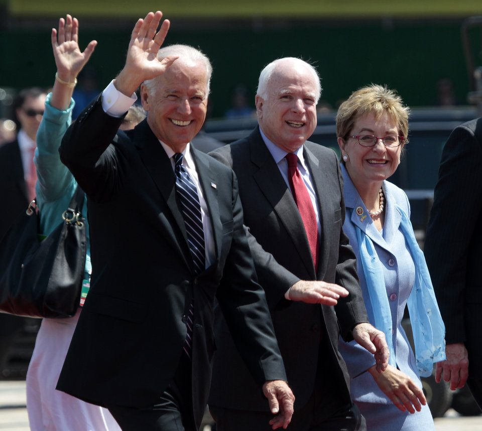 Photo - From left, U.S. Vice President Joe Biden, U.S. Sen. John McCain, R-Ariz., and Rep. Marcy Kaptur, D-Ohio, attend the inauguration ceremony of Ukraine's new President Petro Poroshenko in Kiev, Ukraine, Saturday, June 7, 2014. Petro Poroshenko took the oath of office as Ukraine's president Saturday, assuming leadership of a country mired in a violent uprising and economic troubles.  (AP Photo/Sergei Chuzavkov)