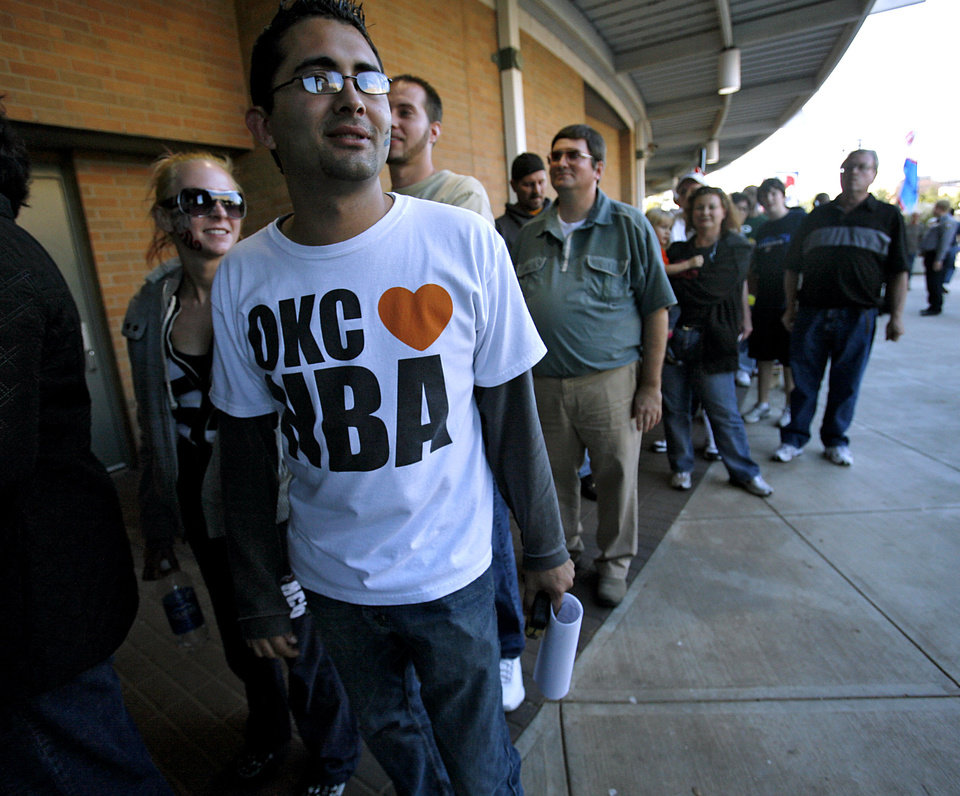OKLAHOMA CITY THUNDER / NBA BASKETBALL TEAM / REGULAR SEASON OPENING NIGHT / FANS: Jay Lulla, of Oklahoma City, waits in line to buy Thunder tickets outside the Ford Center in downtown Oklahoma City on Wednesday, October 29, 2008. By John Clanton, The Oklahoman  ORG XMIT: KOD