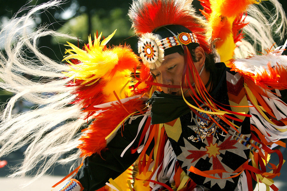 A fancy dancer dances during the annual Red Earth Festival parade in downtown Oklahoma City. Photo by Ashley McKee, The Oklahoman