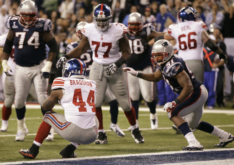 Photo - New York Giants running back Ahmad Bradshaw (44) rushes for a touchdown in front of New England Patriots linebacker Jerod Mayo (51) during the second half of the NFL Super Bowl XLVI football game, Sunday, Feb. 5, 2012, in Indianapolis. (AP Photo/Marcio Jose Sanchez) ORG XMIT: SB459