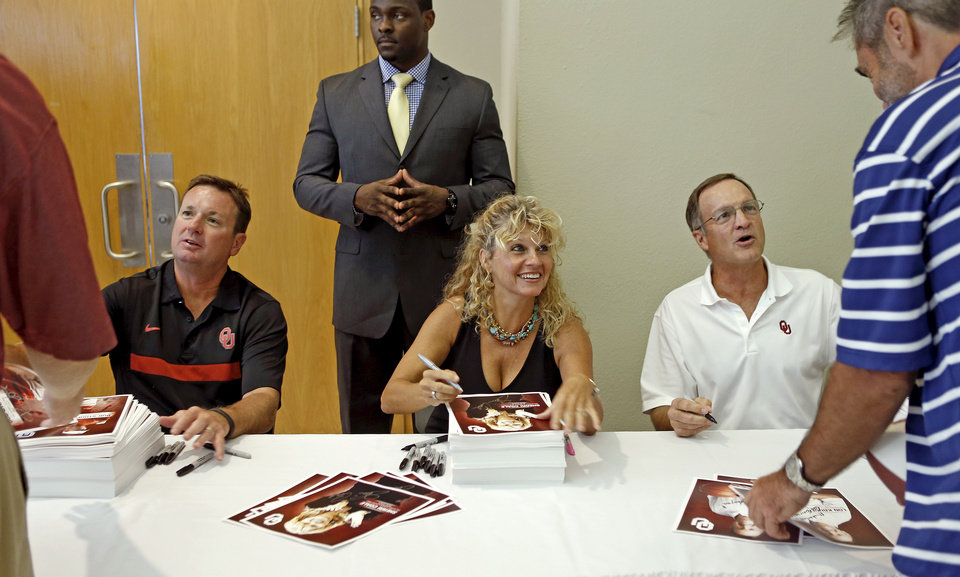 Oklahoma football coach Bob Stoops, left, women's basketball coach Sherri Coale, and men's basketball coach Lon Kruger greet fans during the Sooner Caravan stop at the National Cowboy & Western Heritage Museum  in Oklahoma City, Wednesday, August 1, 2012. Photo by Bryan Terry, The Oklahoman