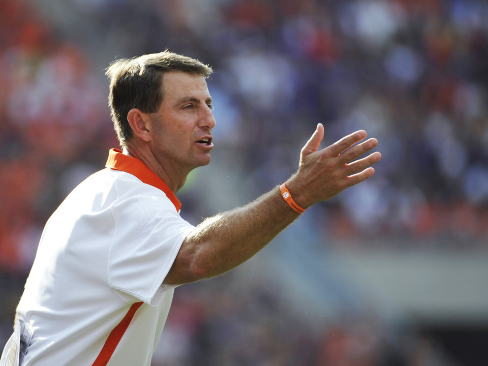 Photo -   Clemson coach Dabo Swinney gestures to an official during the second half of an NCAA college football game against Furman, Saturday, Sept. 15, 2012, in Clemson, S.C. (AP Photo/Rainier Ehrhardt)