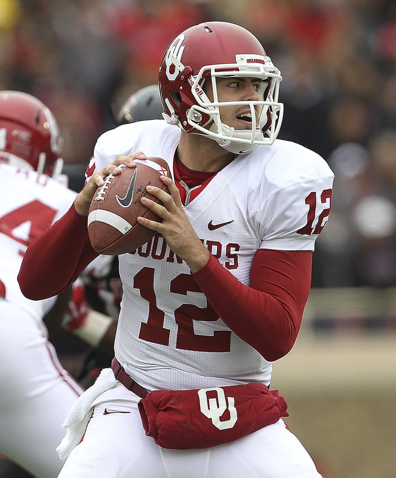 Oklahoma's Landry Jones looks to throw against Texas Tech during an NCAA college football game in Lubbock, Texas, Saturday, Oct. 6, 2012. (AP Photo/Lubbock Avalanche-Journal, Stephen Spillman) LOCAL TV OUT