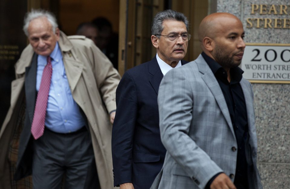 Photo -   Rajat Gupta, center right, leaves federal court in New York on Wednesday, Oct. 24, 2012 after the former Goldman Sachs and Procter & Gamble Co. board member was sentenced Wednesday to 2 years in prison for feeding inside information about board dealings with a billionaire hedge fund owner who was his friend. At left is Gupta's attorney, Gary Naftalis. (AP Photo/Craig Ruttle)
