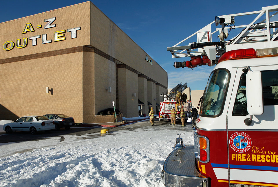 Photo - Midwest City firefighters extinguished a  fire in a vacant mall Thursday morning, Feb. 3, 2011.  Someone set a fire inside a former store called A - Z, said Midwest City Fire Marshal Jerry Lojka. He said the fire was set around 7 a.m. Heritage Park Mall has been closed about two years.  Photo by Jim Beckel, The Oklahoman