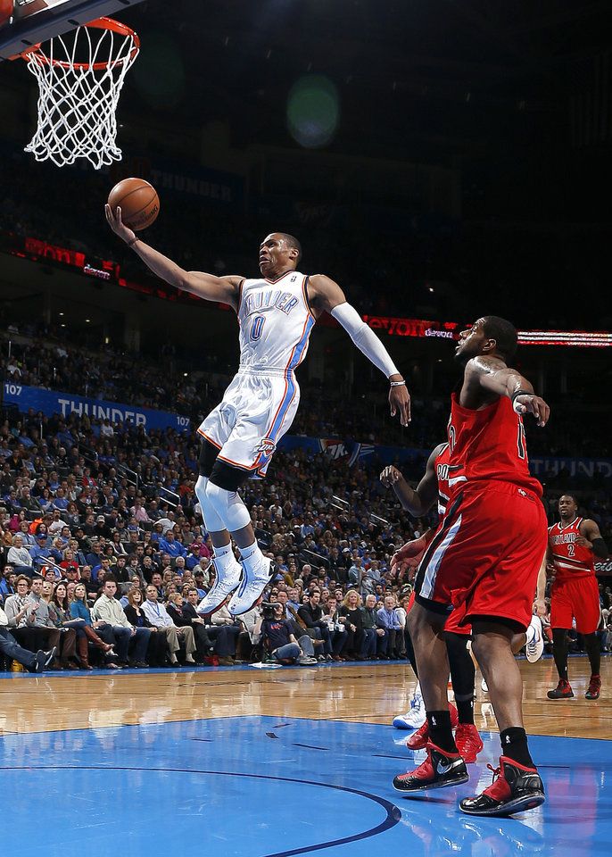 Oklahoma City's Russell Westbrook (0) shoots a lay up during the NBA basketball game between the Oklahoma City Thunder and the Portland Trail Blazers at the Chesapeake Energy Arena in Oklahoma City, Sunday, March, 24, 2013. Photo by Sarah Phipps, The Oklahoman