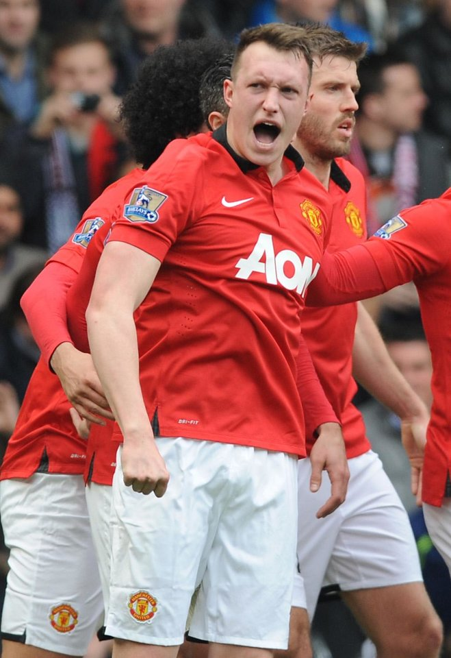 Photo - Manchester United's Phil Jones celebrates after scoring against West Brom during the English Premier League soccer match between West Bromwich Albion and Manchester United at The Hawthorns Stadium in West Bromwich, England, Saturday, March 8, 2014. (AP Photo/Rui Vieira)