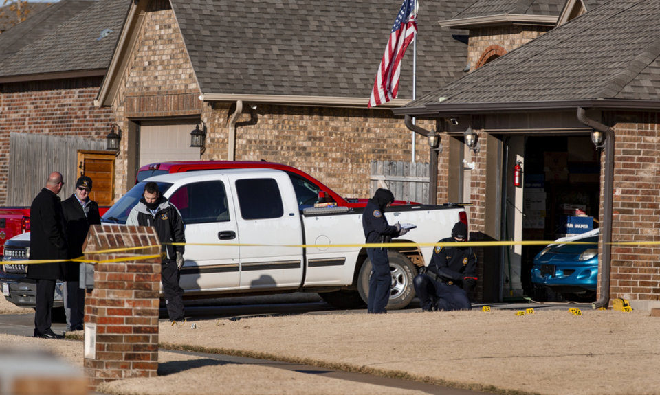 Photo -  Police investigate a scene near SW 33 and Sardis Way in Yukon on Tuesday, where an officer involved shooting killed a suspect thought to be involved in a deadly shooting at the 7-Elevern near Czech Hall Road and Reno Avenue [Chris Landsberger/The Oklahoman]