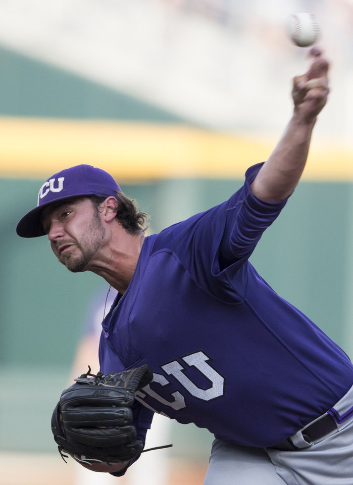 Photo - TCU pitcher Brandon Finnegan delivers against Virginia in the first inning of an NCAA baseball College World Series game in Omaha, Neb., Tuesday, June 17, 2014. (AP Photo/Nati Harnik)