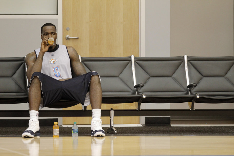 Photo - Thunder player Kendrick Perkins rests at the end of a practice session at the Thunder Practice Facility, Wednesday, Dec. 14, 2011. Photo by Doug Hoke, The Oklahoman