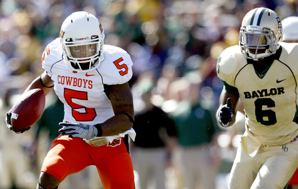 Photo - OSU running back Keith Toston is advancing towards the 18th 1,000-yard rushing season in school history. PHOTO BY SARAH PHIPPS, THE OKLAHOMAN