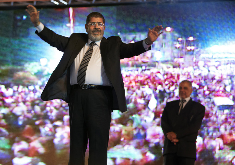 Photo -   FILE - In this Sunday, May 20, 2012 file photo, the Muslim Brotherhood's presidential candidate Mohammed Morsi holds a rally in Cairo, Egypt. The Muslim Brotherhood has declared that its candidate, Mohammed Morsi, won Egypt's presidential election, early Monday, June 18, 2012.(AP Photo/Fredrik Persson, File)