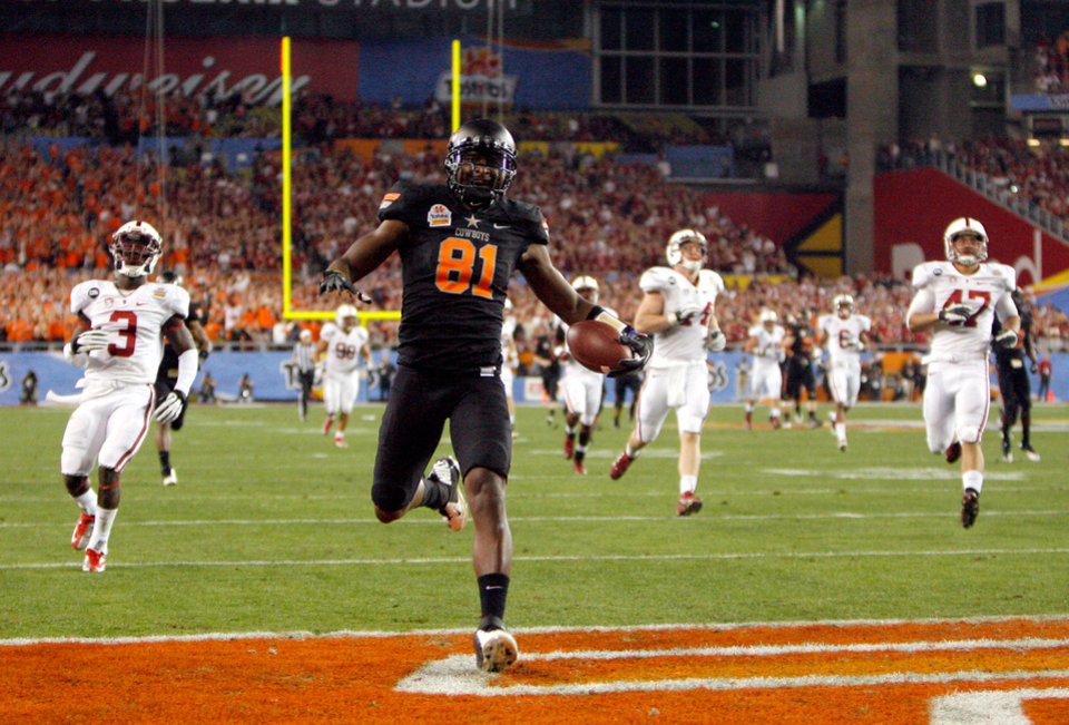 Oklahoma State's Justin Blackmon (81) scores a touchdown during the Fiesta Bowl between the Oklahoma State University Cowboys (OSU) and the Stanford Cardinals at the University of Phoenix Stadium in Glendale, Ariz., Monday, Jan. 2, 2012. Photo by Sarah Phipps, The Oklahoman