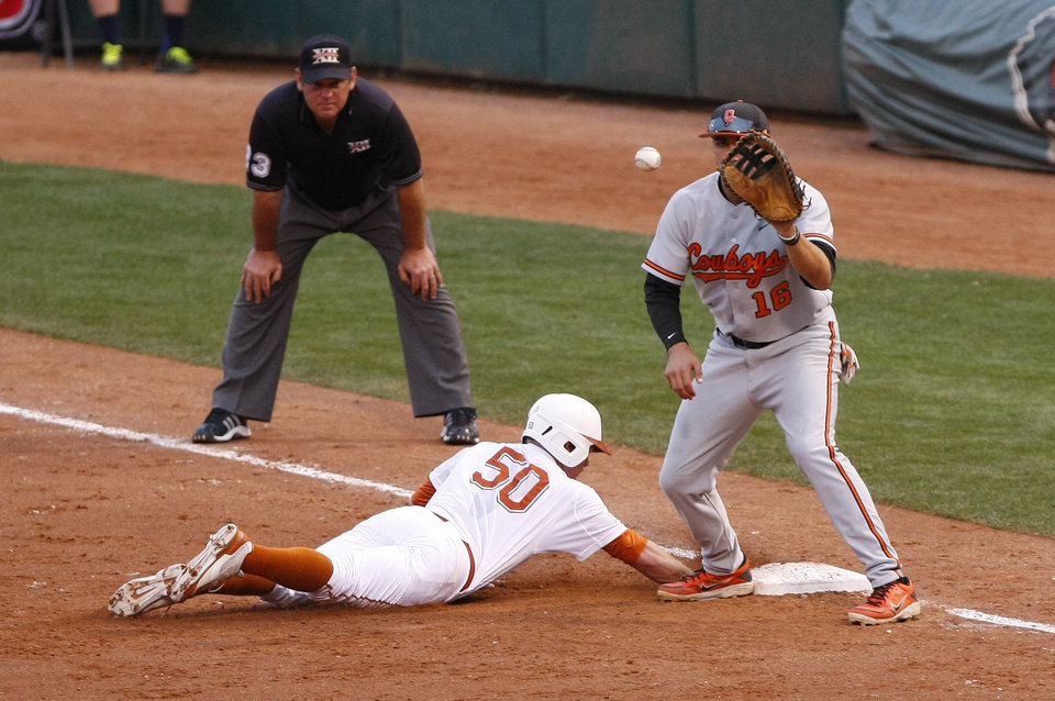 Photo - Texas third baseman Zane Gurwitz beats the throw back to first base in the first inning of a second-round game against Oklahoma State in the Big 12 conference NCAA college baseball tournament in Oklahoma City, Thursday, May 22, 2014. (AP Photo/Alonzo Adams)