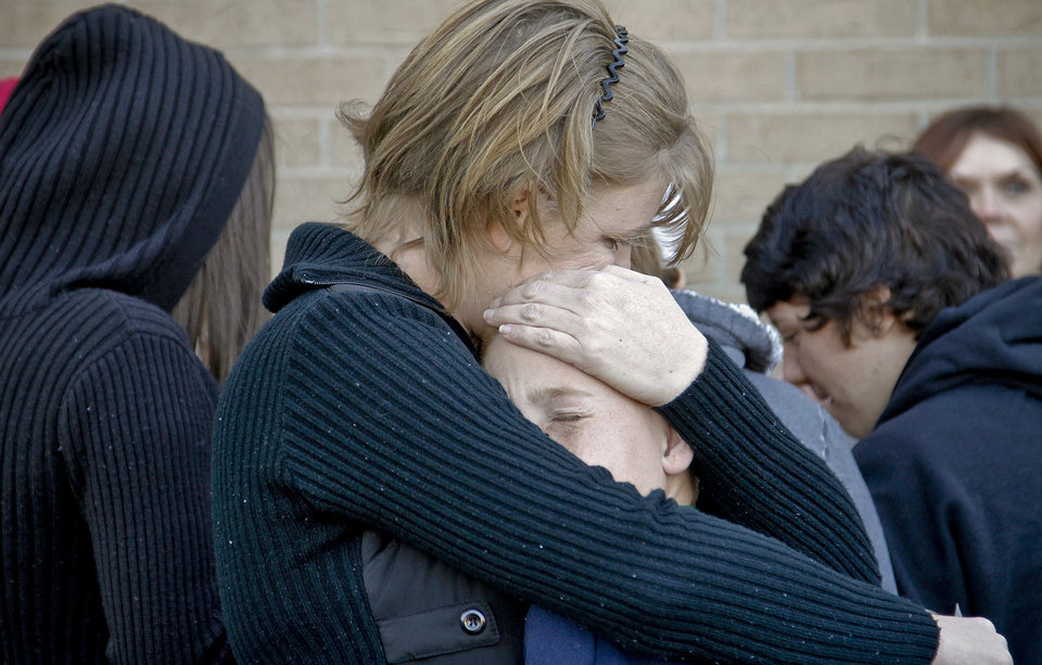 DeAnn Hartman hugs her son Jacob as they gather during a vigil on Tuesday afternoon for Carina Saunders, whose body was found in a duffel bag last week behind a Bethany Homeland last week. PHOTO BY CHRIS LANDSBERGER, THE OKLAHOMAN