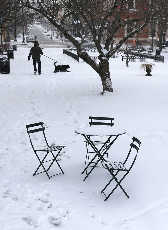 Photo - Snow rests on outdoor furniture in a park in Baltimore, Monday, March 3, 2014. Winter kept its icy hold on much of the country Monday, with snow falling and temperatures dropping as schools and offices closed and people from the Mid-Atlantic to Northeast reluctantly waited out another storm indoors. (AP Photo/Patrick Semansky)