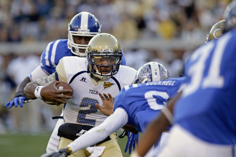 Photo -   Georgia Tech quarterback Vad Lee (2) runs the ball against the defense of Duke's Dezmond Johnson, rear, and Ross Cockrell, near, in the second quarter of an NCAA college football game on Saturday, Nov. 17, 2012, in Atlanta. (AP Photo/David Goldman)