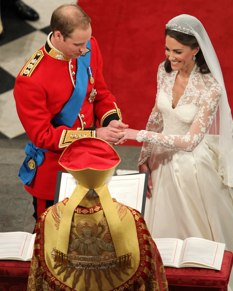 Photo - Britain's Prince William and his bride Kate Middleton exchange rings during their wedding service at Westminster Abbey, London, Friday April 29, 2011. (AP Photo/Andrew Milligan, Pool) ORG XMIT: RWBJ111