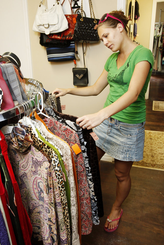 Photo - OKLAHOMA CITY UNIVERSITY / CLOTHES / CLOTHING / RESALE / STORE: Michelle Luneau looks through a rack of clothes at BLUEtique, a resale shop at OCU, in which the sales will fund scholarships. The shop is at NW 23 and Virginia. Photo by Paul Hellstern, The Oklahoman. ORG XMIT: KOD