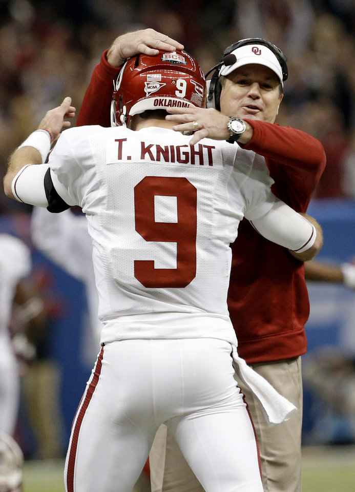 Photo - Oklahoma head coach Bob Stoops congratulates Oklahoma's Trevor Knight (9) on a touchdown during the NCAA football BCS Sugar Bowl game between the University of Oklahoma Sooners (OU) and the University of Alabama Crimson Tide (UA) at the Superdome in New Orleans, La., Thursday, Jan. 2, 2014.  .Photo by Sarah Phipps, The Oklahoman