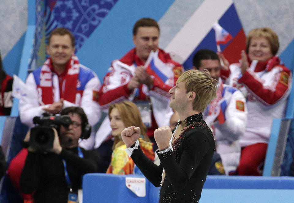 Photo - Evgeny Plyushchenko of Russia celebrates after competing in the the men's team short program figure skating competition at the Iceberg Skating Palace during the 2014 Winter Olympics, Thursday, Feb. 6, 2014, in Sochi, Russia. (AP Photo/Bernat Armangue)