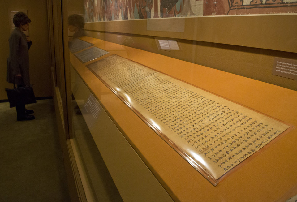 Photo - A handwritten Buddhist scripture, from the Tang Dynasty, 618-907 AD, is displayed in