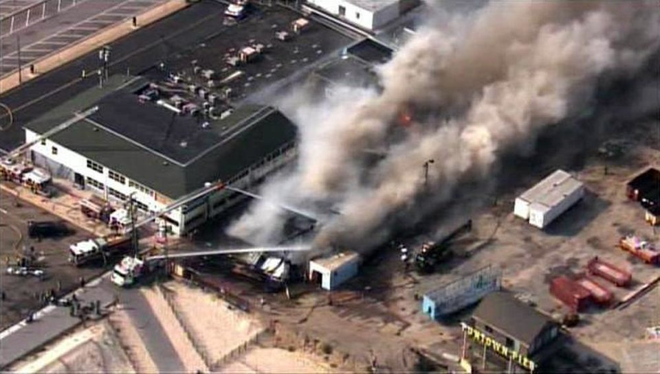 CORRECTS LOCATION TO SEASIDE HEIGHTS INSTEAD OF SEASIDE PARK - In this aerial image taken from video and provided by Fox 29, firefighters battle a raging fire on boardwalk in Seaside Heights, N.J., Thursday, Sept. 12, 2013. The fire apparently started in an ice cream shop then spread several blocks down a New Jersey shore boardwalk that was damaged in Superstorm Sandy and was being repaired. (AP Photo/Fox 29) NO SALES