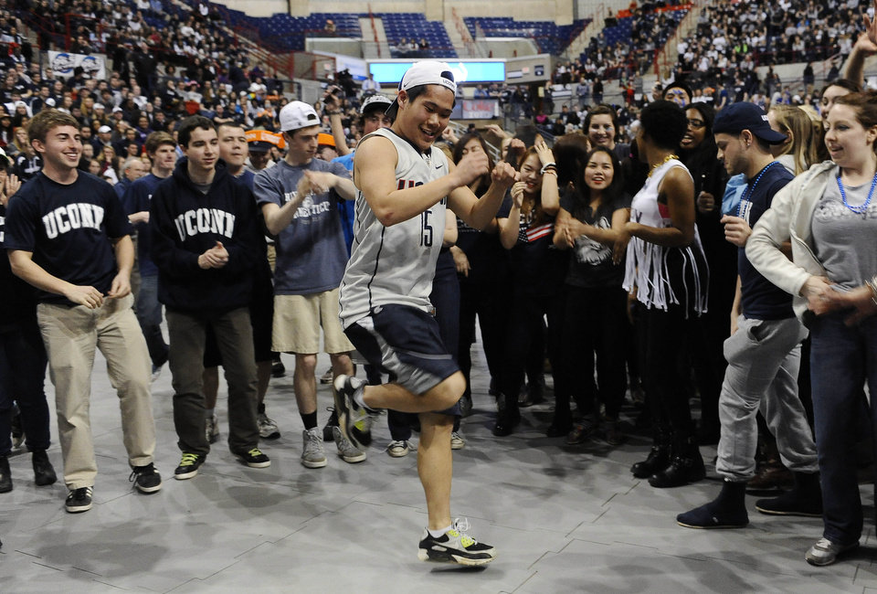 Photo - Hardy Chen of Farmington, Conn. dances at halftime during the broadcast of the UConn and Notre Dame women's basketball game for the NCAA title, Tuesday, April 8, 2014, in Storrs, Conn. (AP Photo/Jessica Hill)